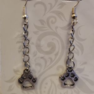 Silver dog paw dangle earrings